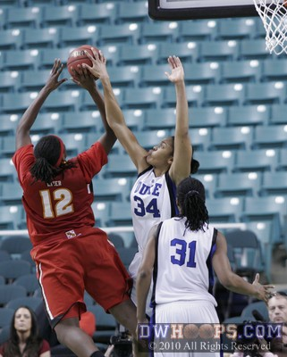 Krystal Thomas rejects Lynetta Kizer in the 2010 ACC Quarterfinals.