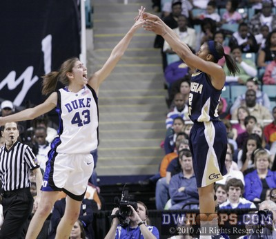 Alex Montgomery shoots over Duke's Allison Vernerey