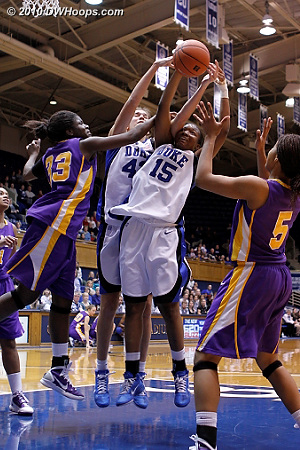 Albany's Tabitha Makopondo gets her arm in between Allison Vernerey and Richa Jackson on Duke's offensive glass.  - Duke Tags: #15 Richa Jackson, #43 Allison Vernerey