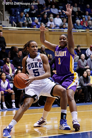 Jasmine Thomas menaces the basket as Albany's Cassandra Callaway tries to intervene.  - Duke Tags: #5 Jasmine Thomas