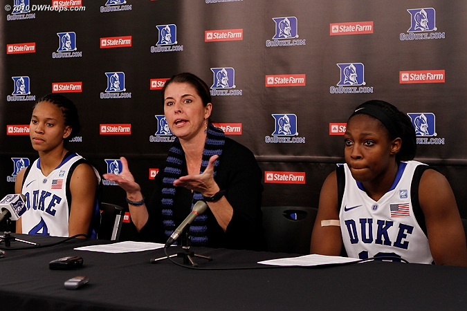 Coach P in the media room with Chloe Wells and Chelsea Gray.