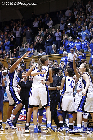 Allison Vernerey is embraced by Haley Peters in the joyous Duke huddle.  - Duke Tags: #43 Allison Vernerey