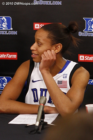 Jas in the media room, hearing high praise from her coach.