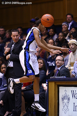 The Xavier staff looks on as Jasmine Thomas does everything she can to try for a loose ball  - Duke Tags: #5 Jasmine Thomas