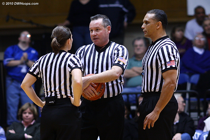 Officials Bonnie Pettus, Bryan Brunette, and Billy Smith huddle during a media timeout.