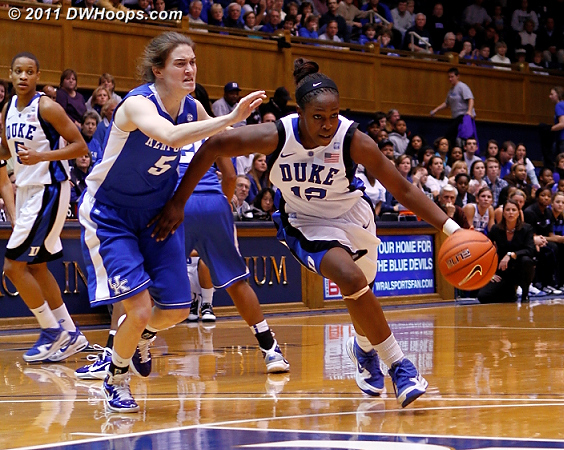 Chelsea Gray drives past Kentucky's Carly Morrow.  - Duke Tags: #12 Chelsea Gray