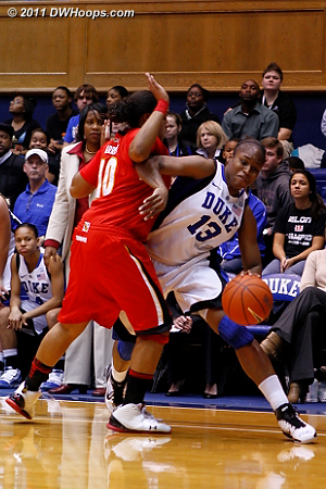 Karima Christmas draws a foul from Anjale Barrett.  - Duke Tags: #13 Karima Christmas