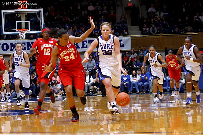 Tricia Liston leads the Duke fast break as Diandra Tchatchouang gives chase.  - Duke Tags: #32 Tricia Liston
