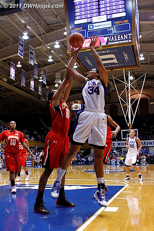 Alicia DeVaughn elevates to block a Krystal Thomas shot