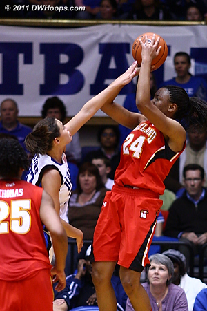 Haley Peters disrupts a Tchatchouang shot  - Duke Tags: #33 Haley Peters 