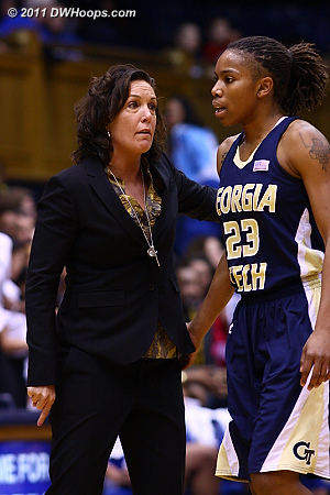 Georgia Tech Head Coach MaChelle Joseph seeks an explanation from Deja Foster after one of Tech's three shot clock violations.