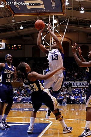 Deja Foster draws a charge from Karima Christmas.  - Duke Tags: #13 Karima Christmas