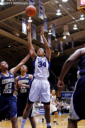 Krystal Thomas is fouled in the paint  - Duke Tags: #34 Krystal Thomas