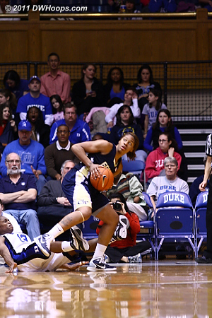 An early second half turning point was Alex Montgomery picking up her third and fourth fouls.  Here Karima Christmas draws Alex's third.  - Duke Tags: #13 Karima Christmas