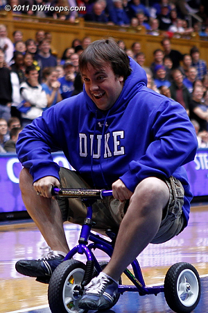 The guy with shorter legs won the trike race  - Duke Tags: Fans