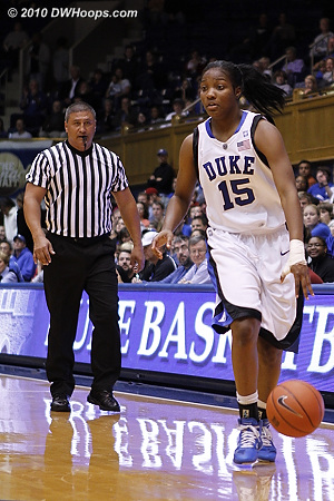Veteran official Bryan Enterline watches the dribble of freshman Richa Jackson.  - Duke Tags: #15 Richa Jackson