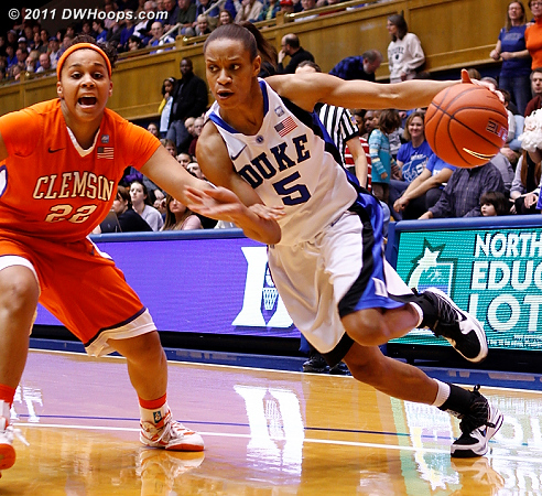 Jasmine Thomas drives by Sthefany Thomas on her way to scoring Duke's first hoop of the night.