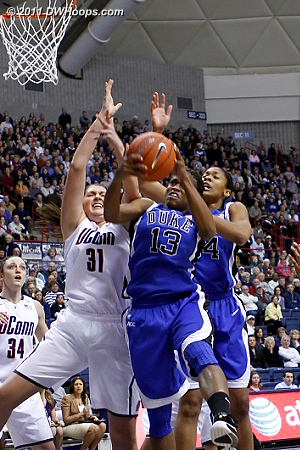 Karima yanks an offensive board down, just out of the clutches of Stefanie Dolson (31)  - Duke Tags: #13 Karima Christmas