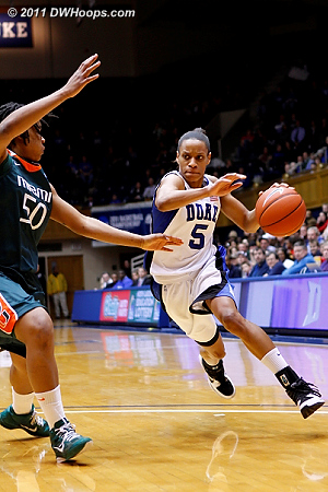 A determined Jasmine Thomas drives on Maria Brown.  Thomas would not score in the first half.  - Duke Tags: #5 Jasmine Thomas
