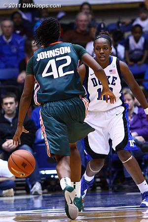 Chelsea Gray gets in position as Shenise Johnson drives  - Duke Tags: #12 Chelsea Gray 