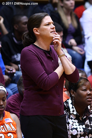 Coach Dunkenberger appears perplexed, perhaps by her team's lack of competitiveness