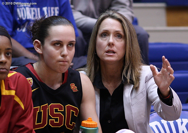 USC assistant Laura Beeman counsels Jacki Gemelos after her second quick foul.