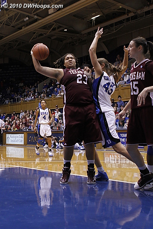The powerful Danielle Adams reels in a defensive rebound.