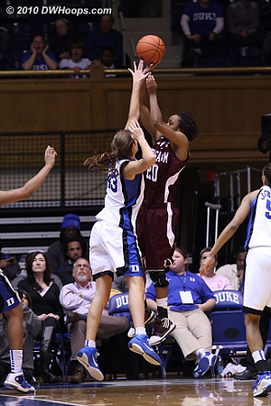Tyra White sinks a baseline J over Vernerey as the lead trading continued.  - Duke Tags: #43 Allison Vernerey