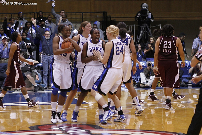 Karima Christmas cradles the game ball as Chelsea Gray tells Kathleen Scheer how happy she is.  - Duke Tags: #12 Chelsea Gray, #13 Karima Christmas