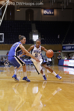 Jasmine Thomas drives around Haley Peters.