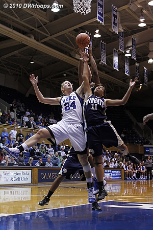 Kathleen Scheer goes high for a rebound, battling with Janitsha Williams (#11)