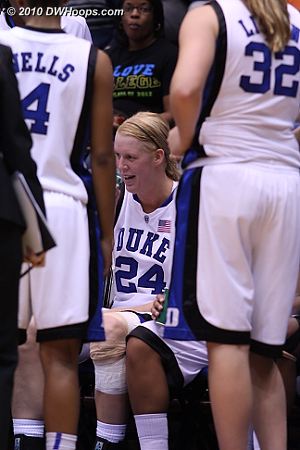 A happy Scheer on the bench  - Duke Tags: #24 Kathleen Scheer