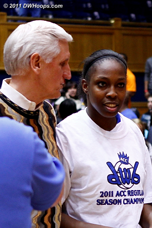 With Al Brown, Chelsea shows off her DWB champs shirt.  Nobody knit Al a DWB champs sweater.  - Duke Tags: Al Brown, #12 Chelsea Gray