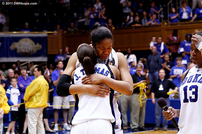 Karima takes the microphone from Krystal as the Thomases embrace  - Duke Tags: #5 Jasmine Thomas, #13 Karima Christmas, #34 Krystal Thomas
