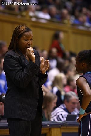 UNC-W coach Cynthia Cooper-Dyke speaks with guard Alisha Andrews