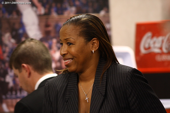 Cynthia Cooper-Dyke leaves the media room after her press conference