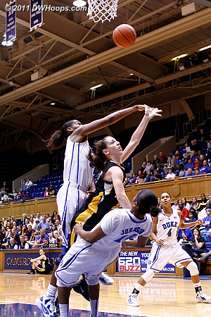 Ka'lia Johnson draws a charge as Amber Henson swats the ball away  - Duke Tags: #14 Ka'lia Johnson, #30 Amber Henson 