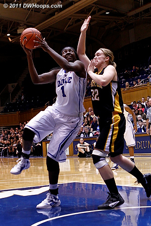 Elizabeth Williams takes on Christina Harvey (32) in the paint  - Duke Tags: #1 Elizabeth Williams