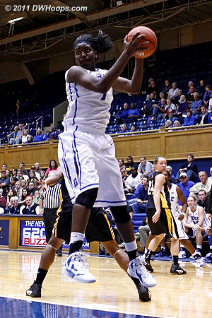 Elizabeth Williams gathers one of seven offensive rebounds  - Duke Tags: #1 Elizabeth Williams