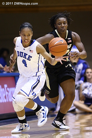 Chloe Wells gets her right arm grabbed by Chantel Poston after knocking the ball away  - Duke Tags: #4 Chloe Wells