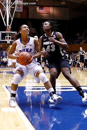 On the other end, Wells eyes the basket as Poston (43) looms  - Duke Tags: #4 Chloe Wells