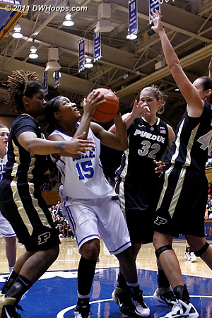 Richa in the middle of a triple team down low, drawing a foul  - Duke Tags: #15 Richa Jackson