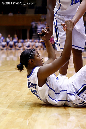 Chelsea helps Richa up after the Purdue foul  - Duke Tags: #15 Richa Jackson