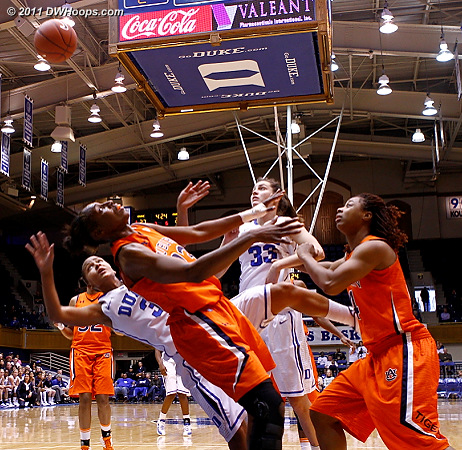 Shay Selby draws a foul from Chantel Hilliard (center)  - Duke Tags: #3 Shay Selby