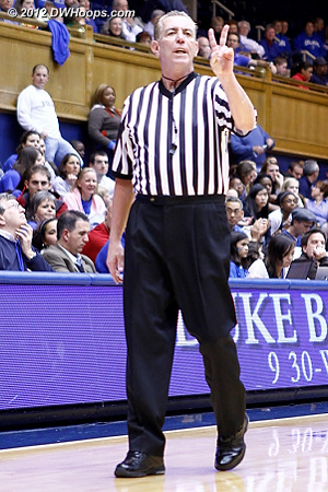 Referee Dennis DeMayo signals two shots for Elizabeth Williams
