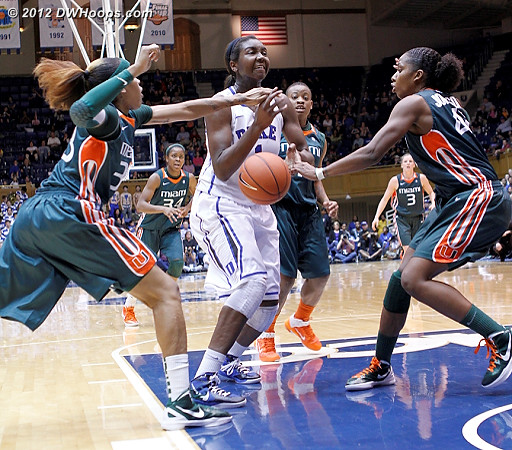 Williams stripped in the lane by the swarming Miami defense  - MIA Players: #33 Suriya McGuire, #42 Shenise Johnson