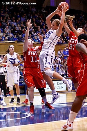 Tricia Liston grabs an offensive rebound