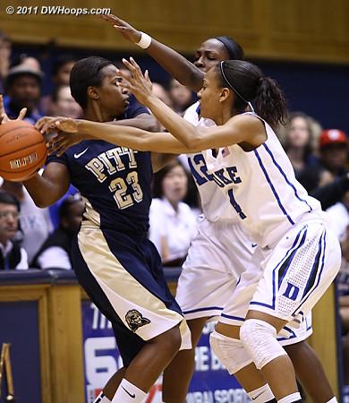 Duke guards swarm Ashlee Anderson (23)  - Duke Tags: #4 Chloe Wells, #12 Chelsea Gray