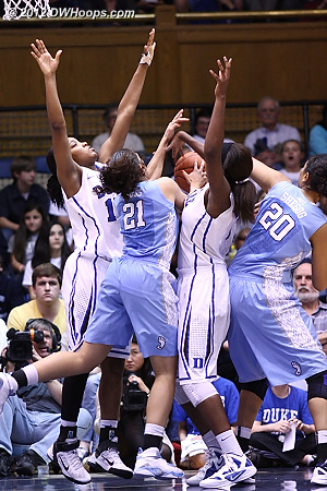 A battle for the ball  - Duke Tags: #1 Elizabeth Williams, #15 Richa Jackson - UNC Players: #20 Chay Shegog, #21 Krista Gross