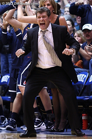 UConn coach Geno Auriemma screaming for his team to box out after a three pointer put them up by 15  - CONN Players: Head Coach Geno Auriemma